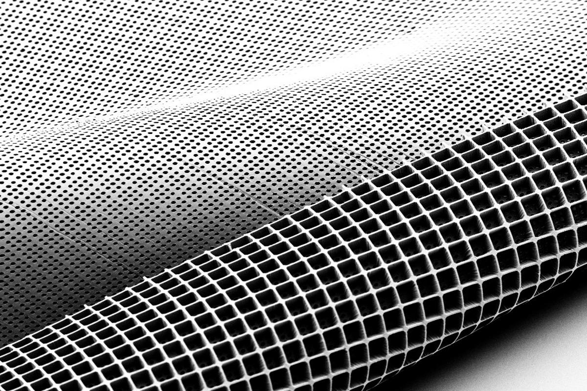 An electron microscope image shows both sides of the newly developed retinal patch material, which is shaped like an ice cube tray