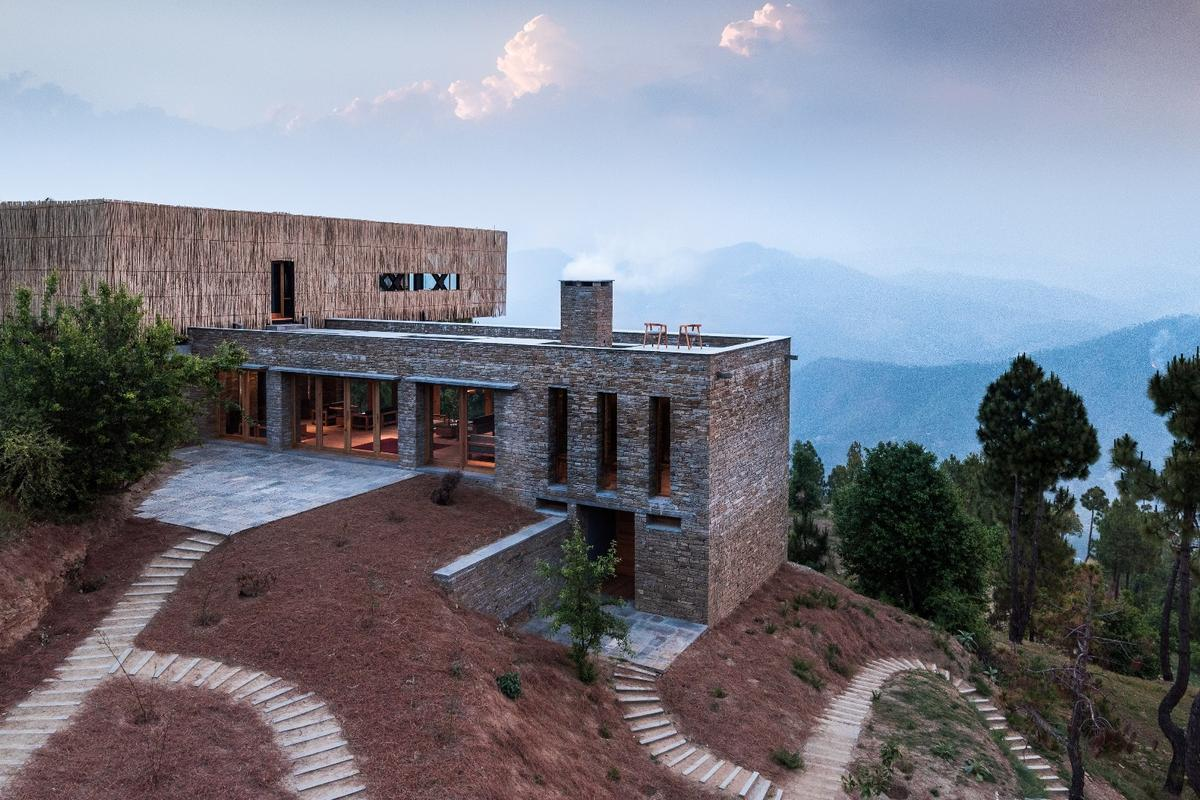 The Kumaon Hotel features a cantilevered dining room that juts out over the valley below