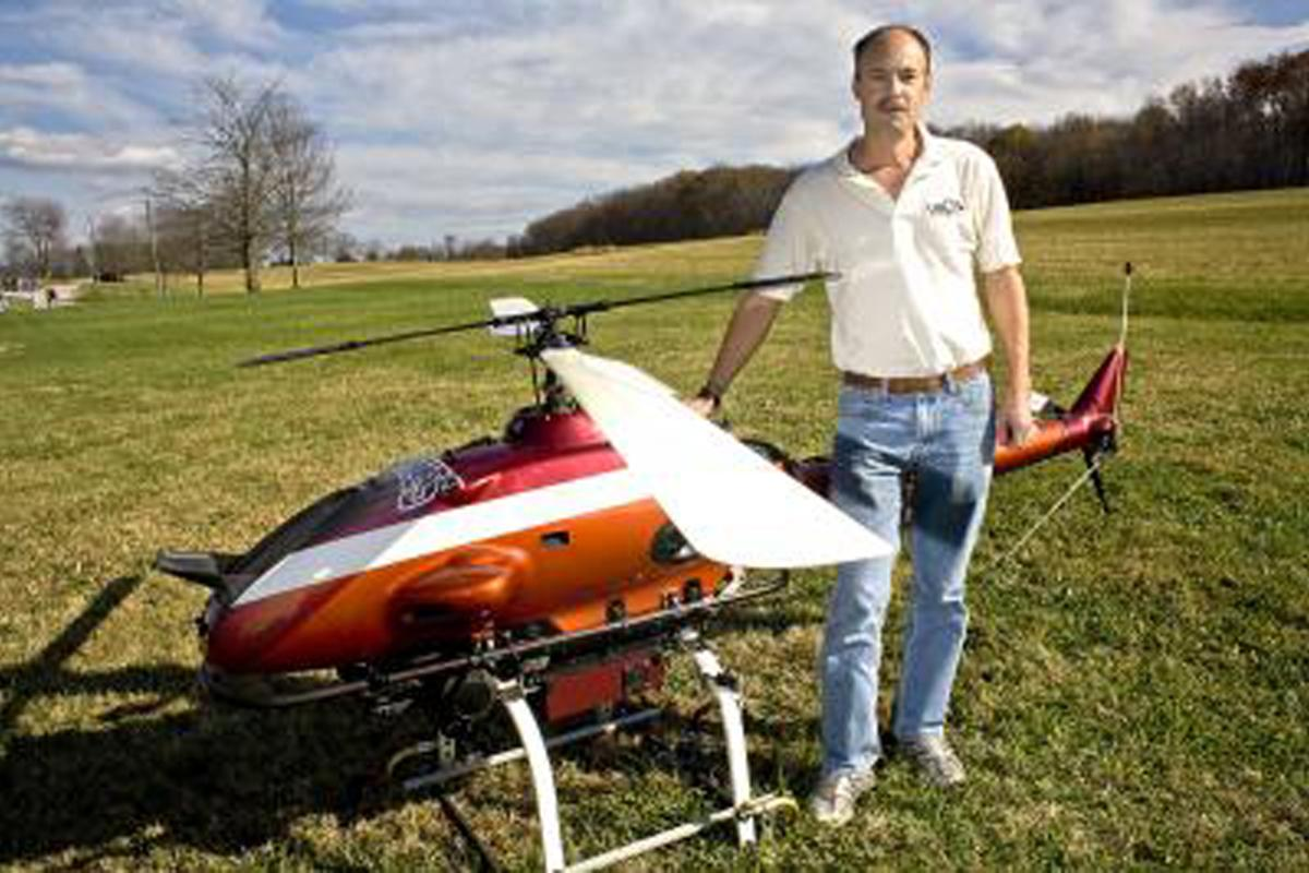 Project Leader Kevin Kochersberger and the autonomous helicopter designed to fly into cities blasted by a nuclear weapon or dirty bomb (Image: Virginia Tech)