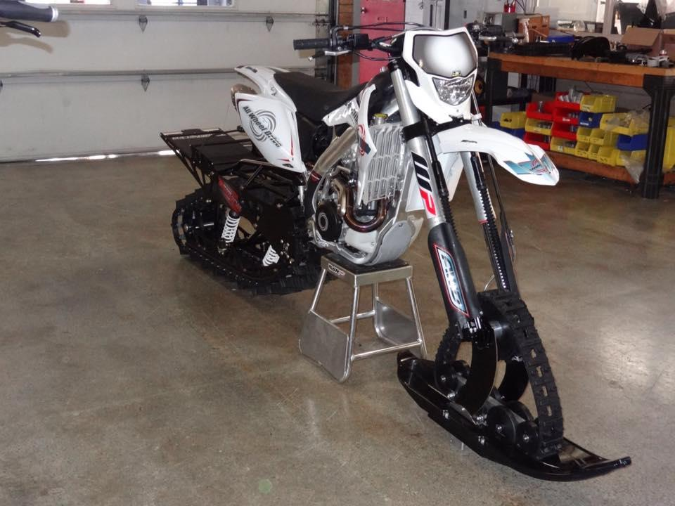 Christini's II-Track Snow Bike system  must be added to one of the company's existing all-wheel-drive motorbikes