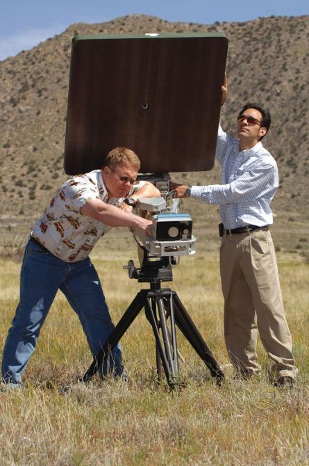 Nonlethal weaponry — Sandia researchers Willy Morse and James Pacheco fine-tune the small-sized Active Denial System. (Photo by Randy Montoya)