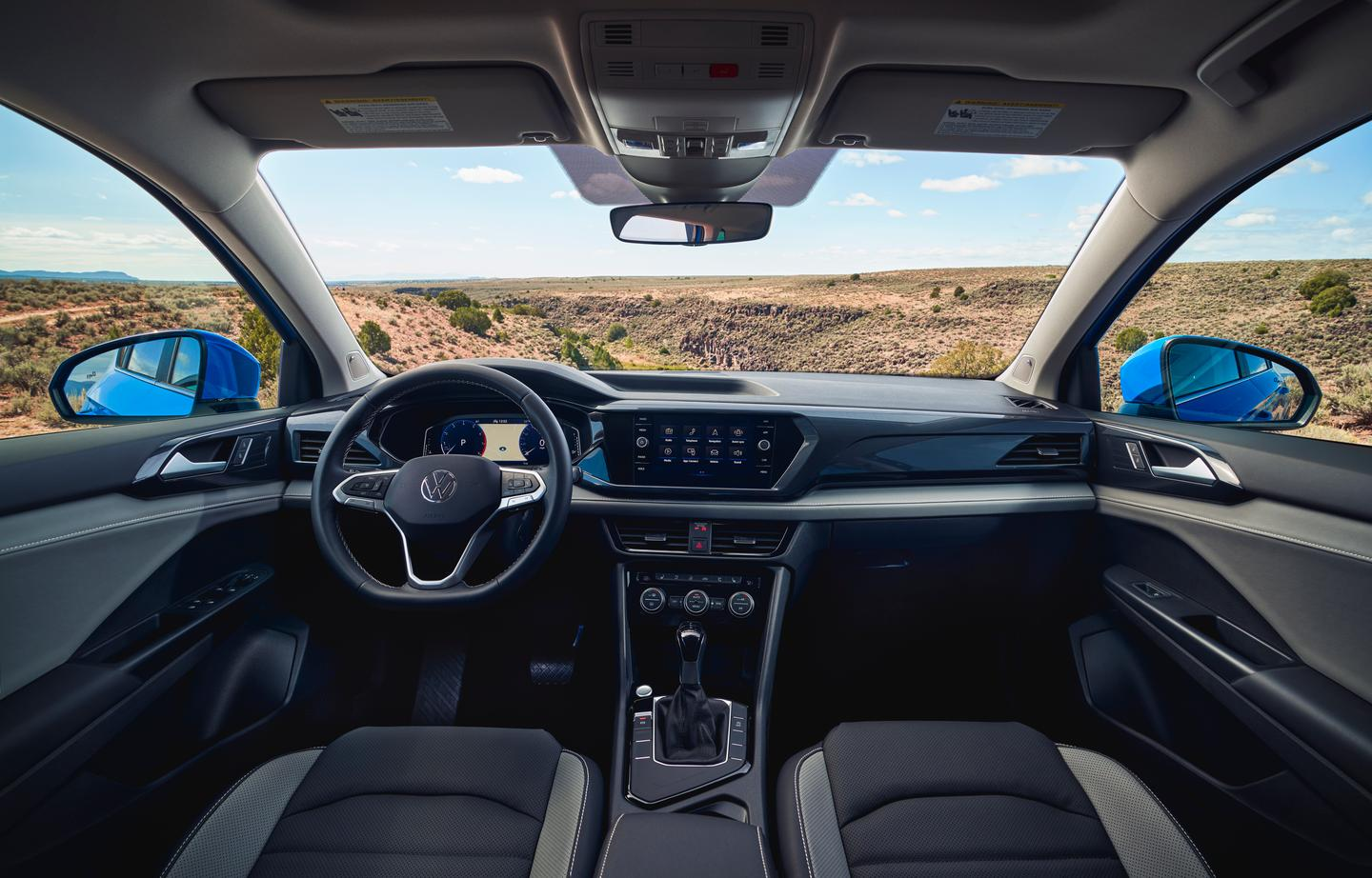 The touchscreen and shifter surrounds angle just enough to let you know it's the driver's equipment