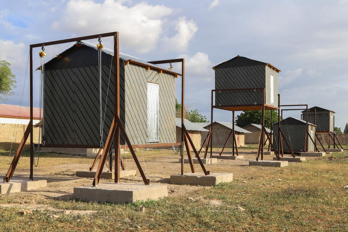 The four adjustable-height huts utilized in the study