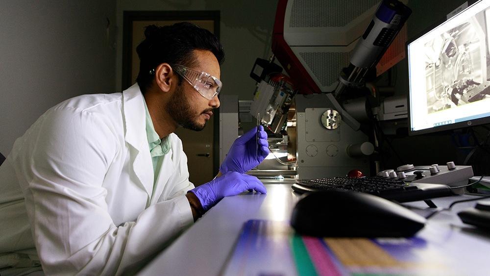 Lead author Hemant Rathod, with a sample of the self-healing ceramic material, chromium aluminum carbide