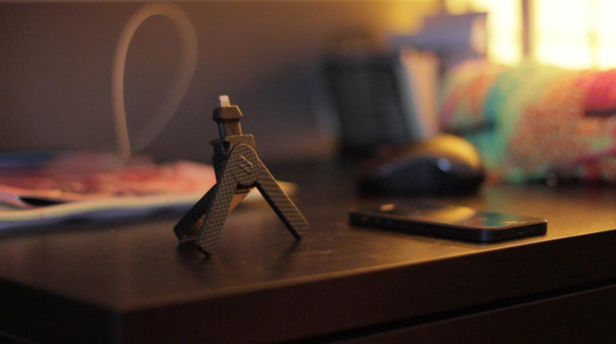ChargeDrive is a thumb drive, mount, tripod, and charger