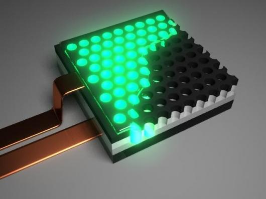 The COLED-polymer combination displaying green light. (Photo: SRI International, Menlo Park,Calif.)