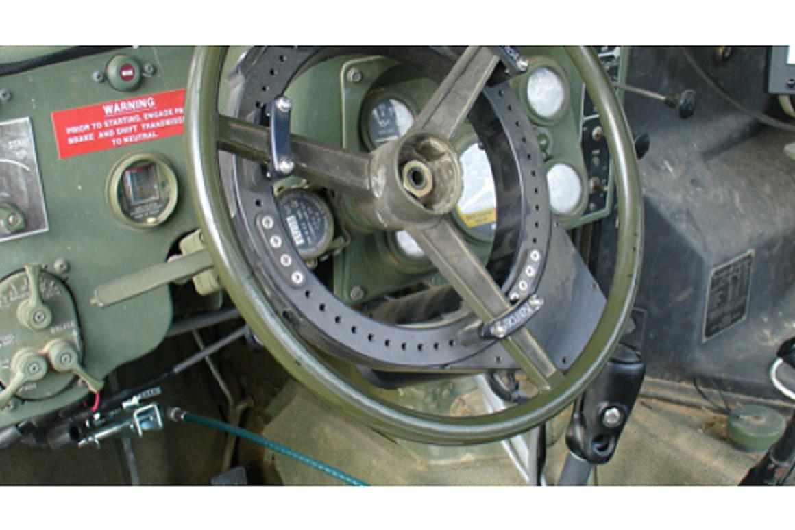 The Pronto4 installed on the steering wheel of a military vehicle