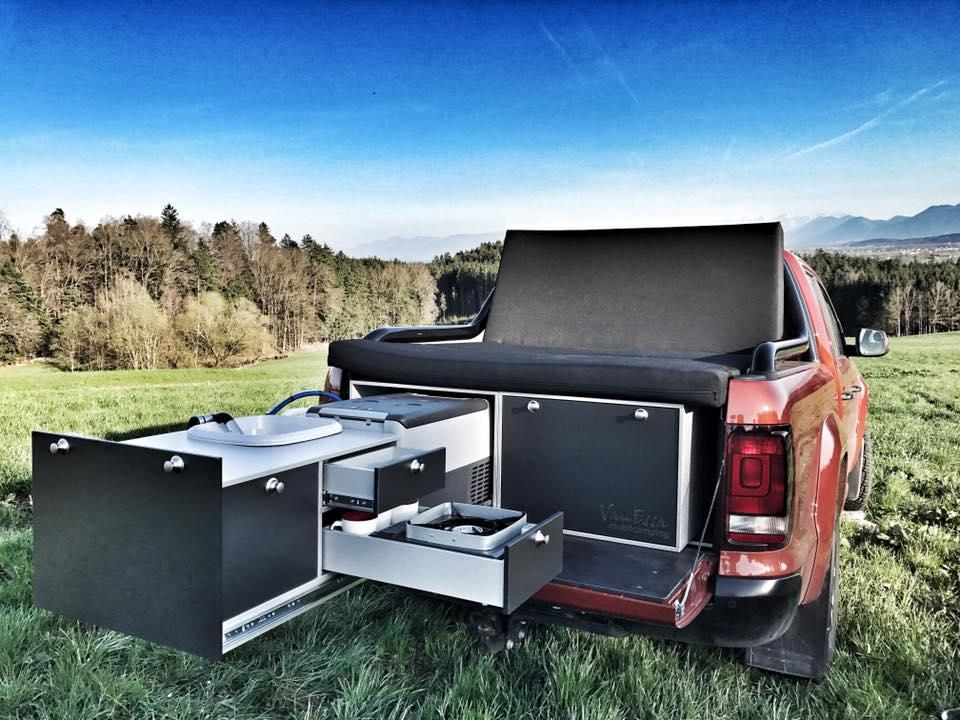 The VanEssa kitchen and folding mattress combo here turns the Volkswagen Amarok into a serious tailgating machine