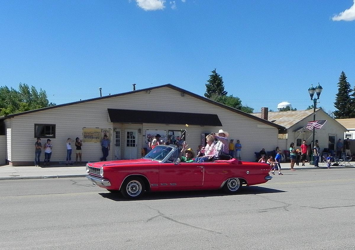 Escorting the grand marshals of the parade held annually by the little town of Albin, Wyoming, the 1965 Dodge Dart GT Convertible with newly-installed RimBlades