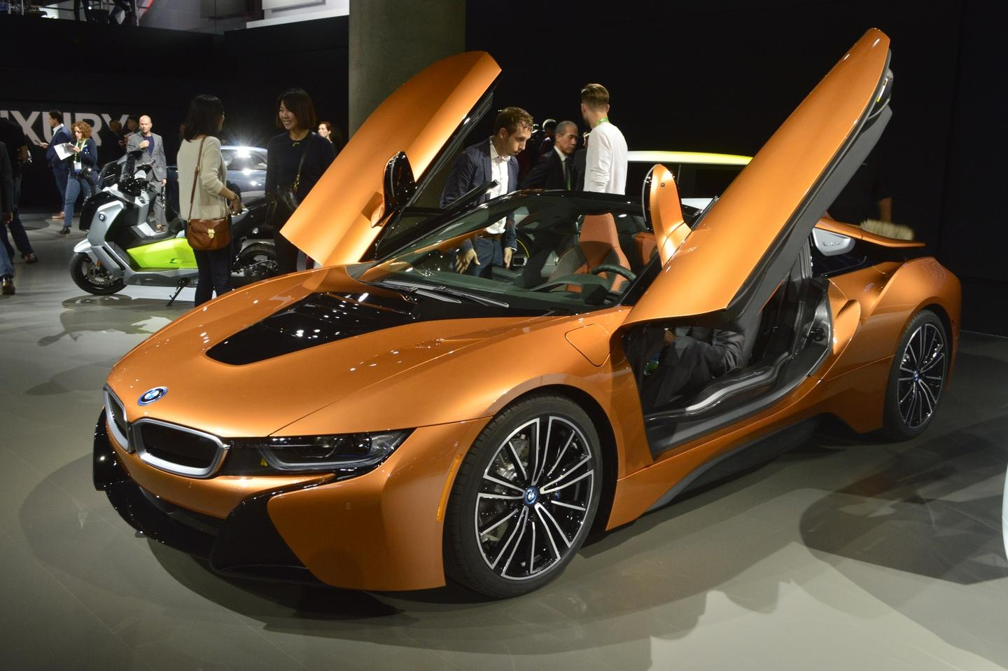 The BMW i8 began selling in 2014 as a 2+2 coupe made of carbon fiber and pure hybrid awesomeness