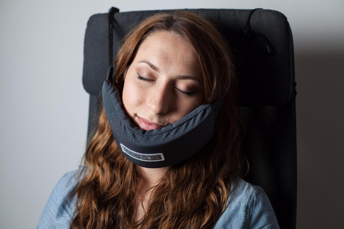 The NodPodcomprises cords that slip over therear of aseat orheadrest to secure a support upon which the user rests her chin