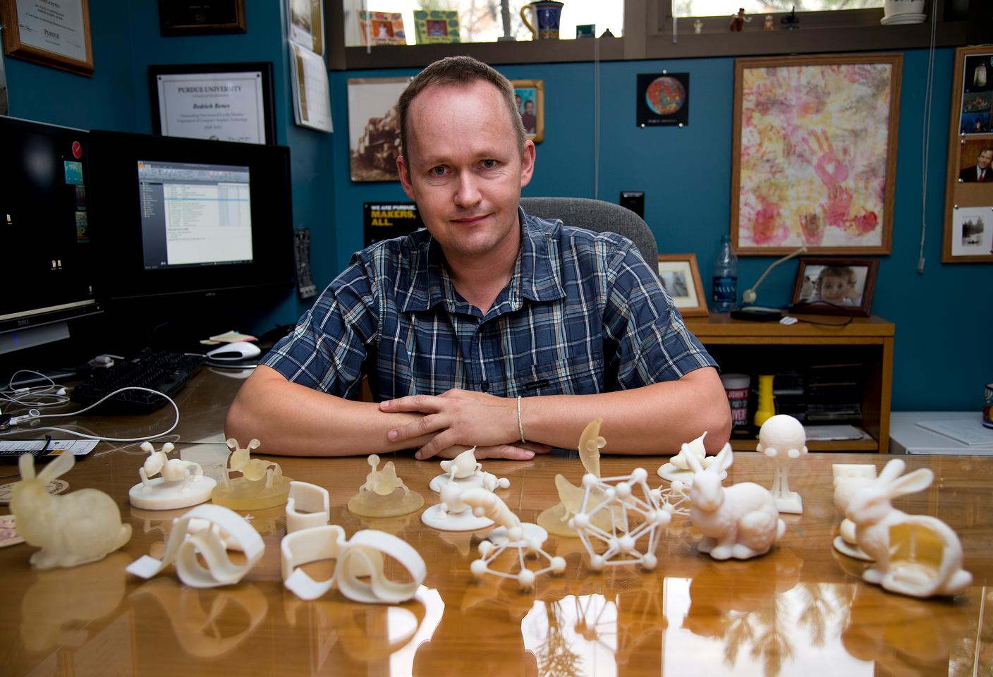 Purdue associate professor of computer graphics Bedrich Benes, with an assortment of objects made with and without the software