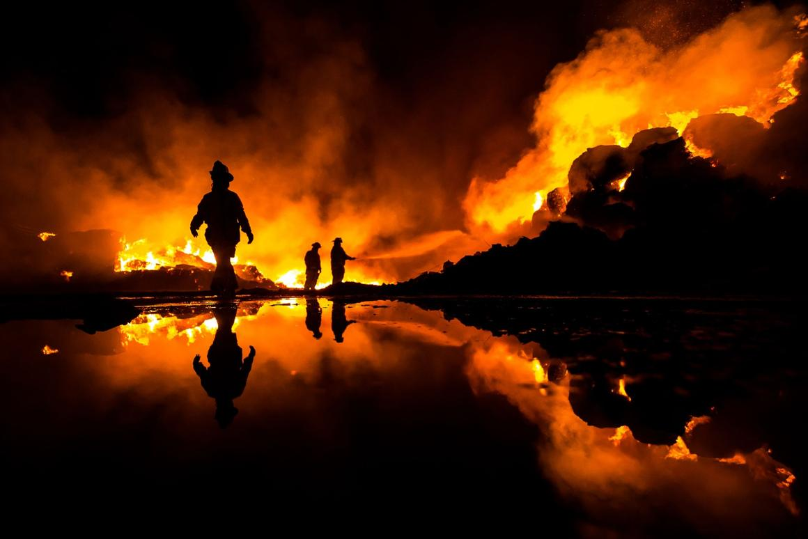 Heroic work of the firefighters of Mexicali Baja California Mexico attending a gigantic fire of a recycling plant fire - 1st place winner in the National Awards for Mexico