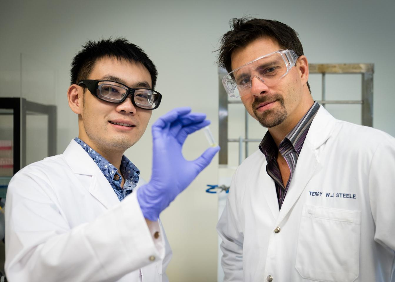 NTU Asst Prof Terry Steele (right) with his researcher Gao Feng have developed a glue that hardens when an electrical voltage is applied