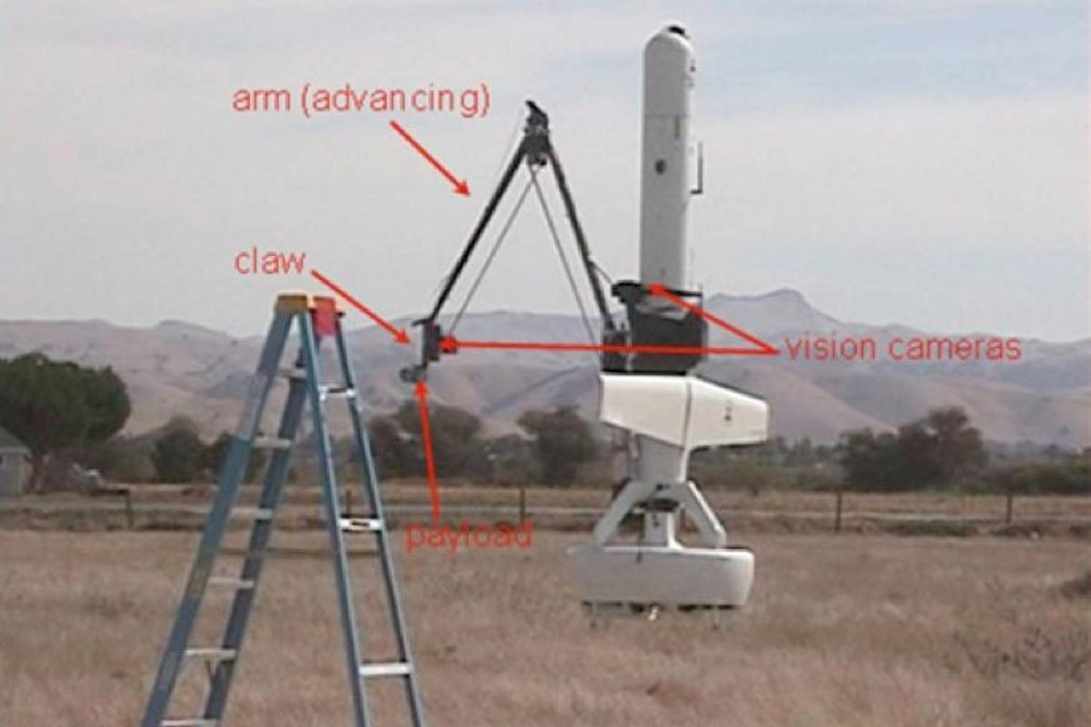 The arm-equipped UAV placing its payload on the ladder target