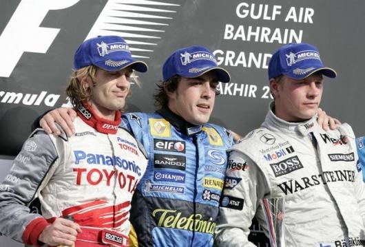 Toyota's Jarno Trulli, Renault's Fernando Alonso and McLaren's Kimi Raikkonen on the victory dias