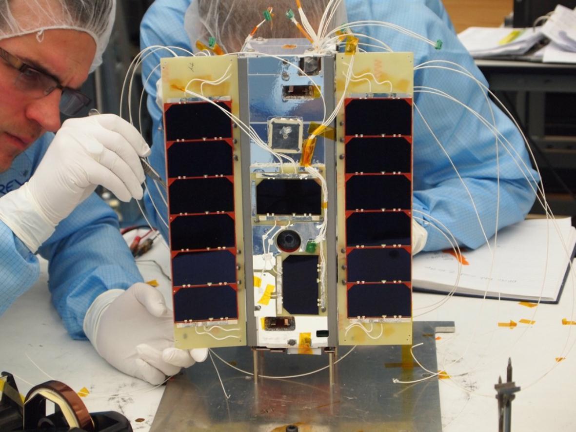 STRaND-1 having its solar panels atached