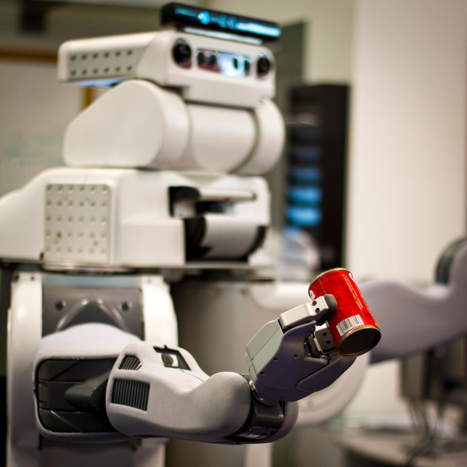 The researchers test their program on a real-life robot, which is able to decide that a can needs to be picked up, then plan and execute the actual motions necessary to lift it from a table (Image: Melanie Gonick)