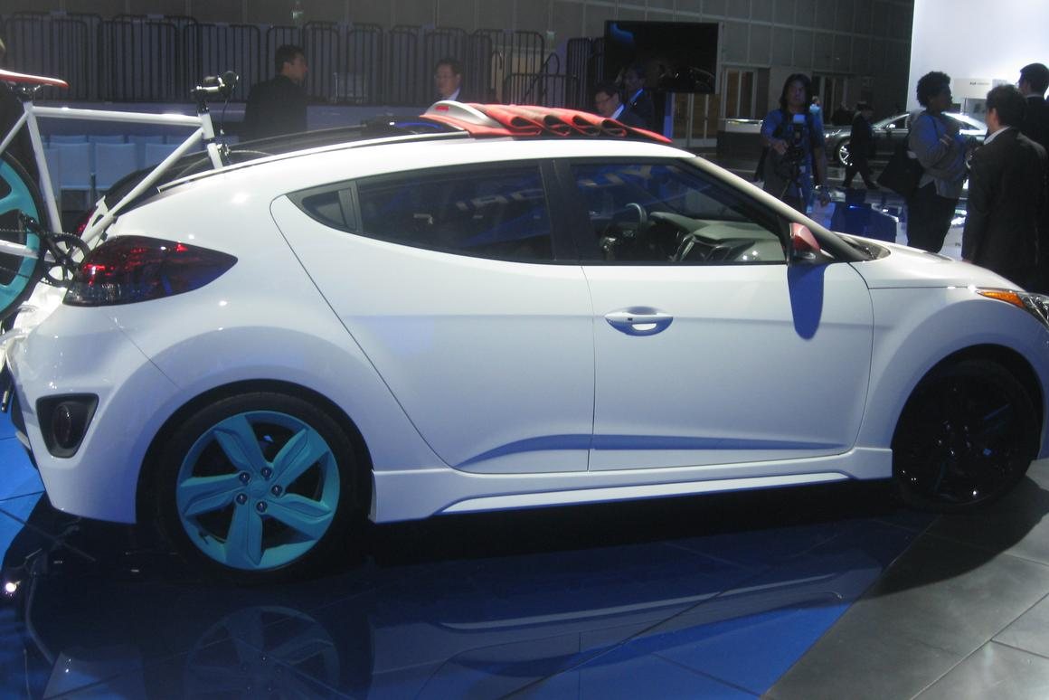 The Veloster C3's top slides forward to open up space in back