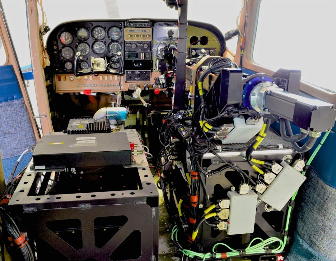 Rear view of the installed ROBOpilot system during preflight for first flight