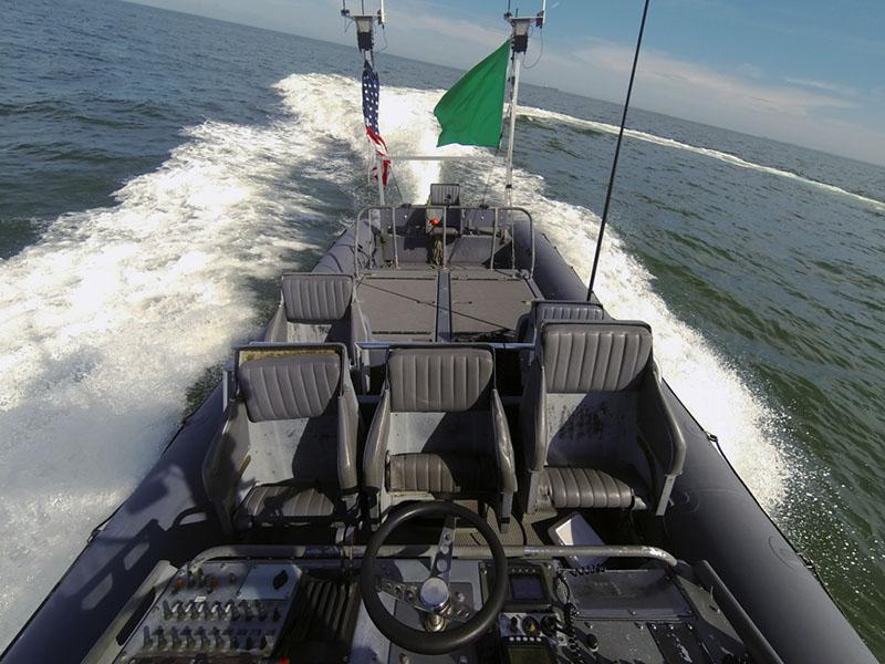 An unmanned rigid-hull inflatable boat operates autonomously during an Office of Naval Research (ONR)-sponsored demonstration of swarmboat technology
