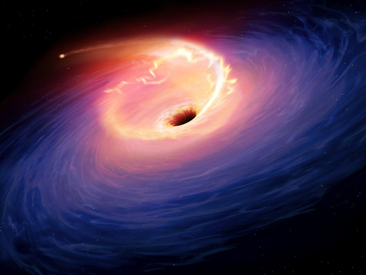 This artist's rendering of the tidal disruption event in F01004-2237 shows the release of gravitational energy and a flare of light as the debris of the star is swallowed by the black hole