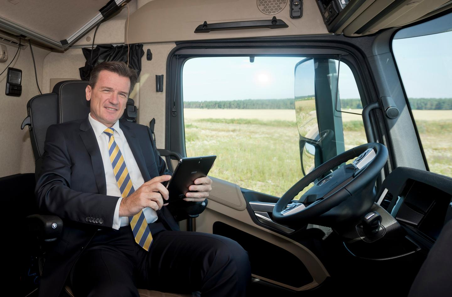 Dr Wolfgang Bernhard in the cockpit of the autonomous truck