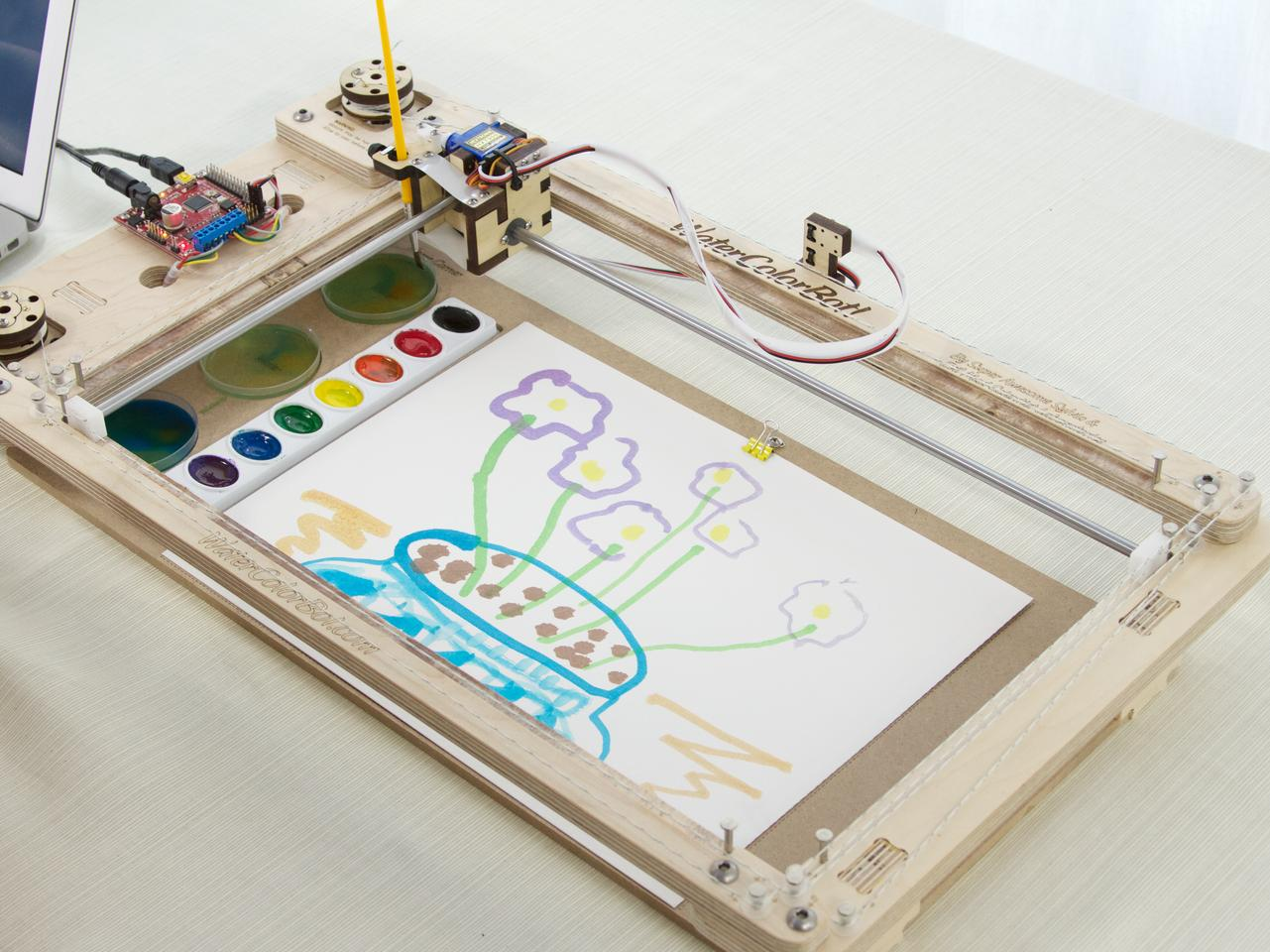 The WaterColorBot doesn't require any pricey or hard-to-find materials to paint, just a set of standard watercolors, a small paintbrush, and a sheet of paper