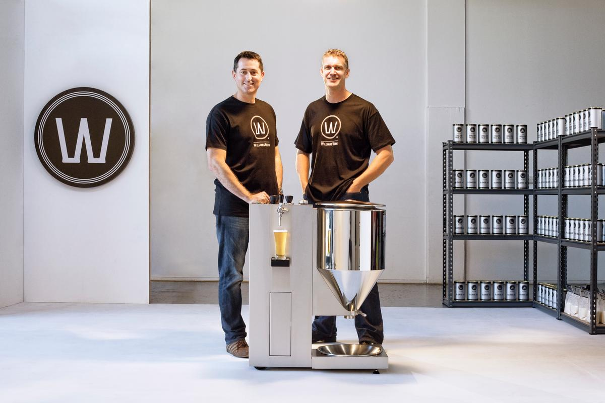 Ian Williams and and Anders Warn, with the WilliamsWarn beer brewing machine