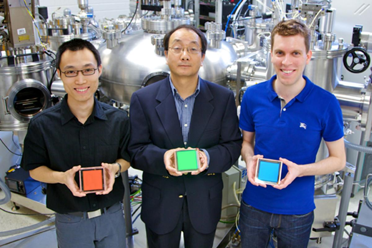 L to R: Zhibin Wang (PhD Candidate), Professor Zheng-Hong Lu, and Michael Helander (PhD Candidate Vanier Canada Graduate Scholar) hold their Cl-ITO enabled OLED devices