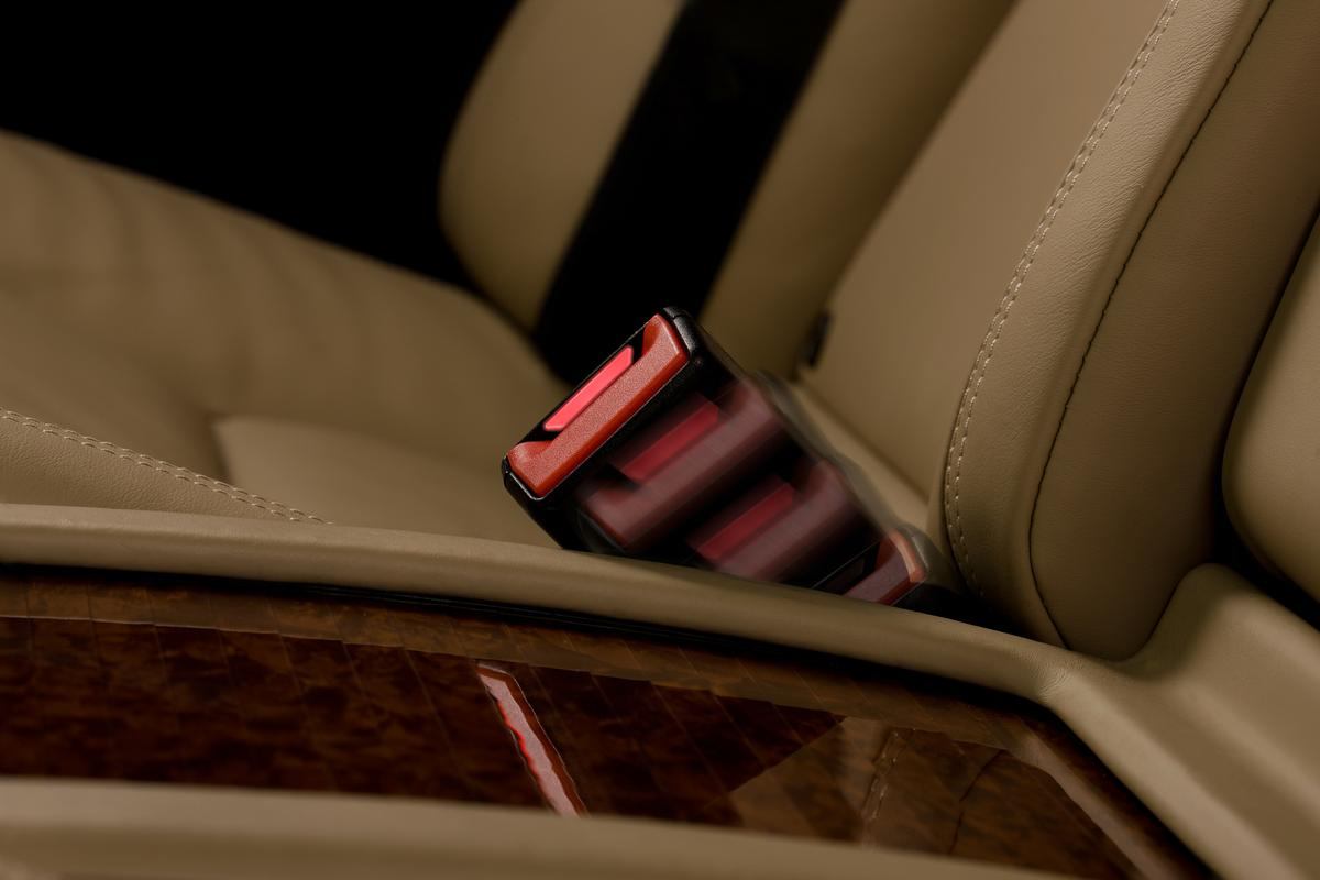 Mercedes' active seat-belt buckle extends from the upholstery when the rear door is opened