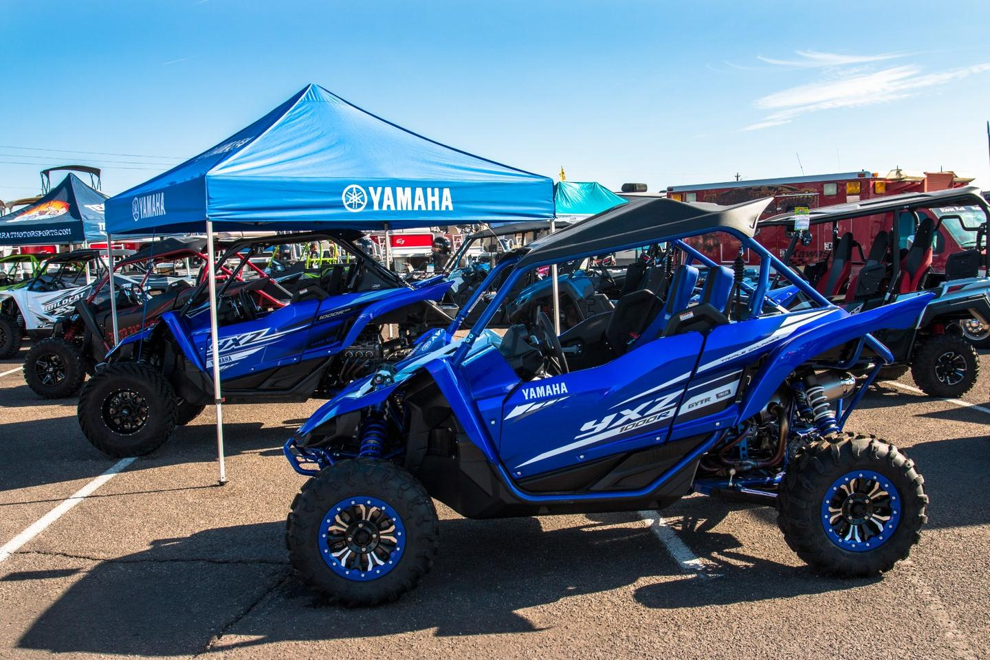 Yamaha's 2019 YXZ 1000Rand YXZ 1000RSS, made for the side-by-side driver who wants a more visceral driving experience. For 2019, Yamaha's lowered the transmissions gear ratio by 24 percent, whilethe new,bigger wheel and tire size results in thefinal drive gear ratio beinglowered by 16 percent, making slower speeds and more technical trails easier