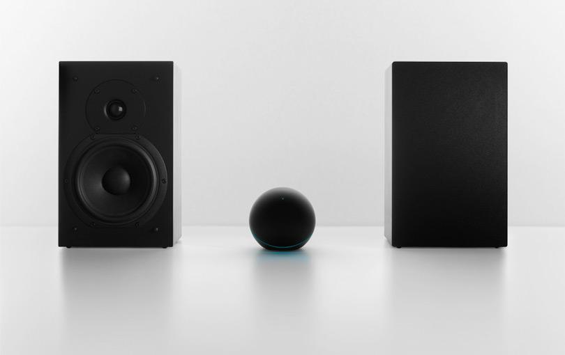 The Nexus Q has a 25 W amp for connecting a couple of bookshelf speakers