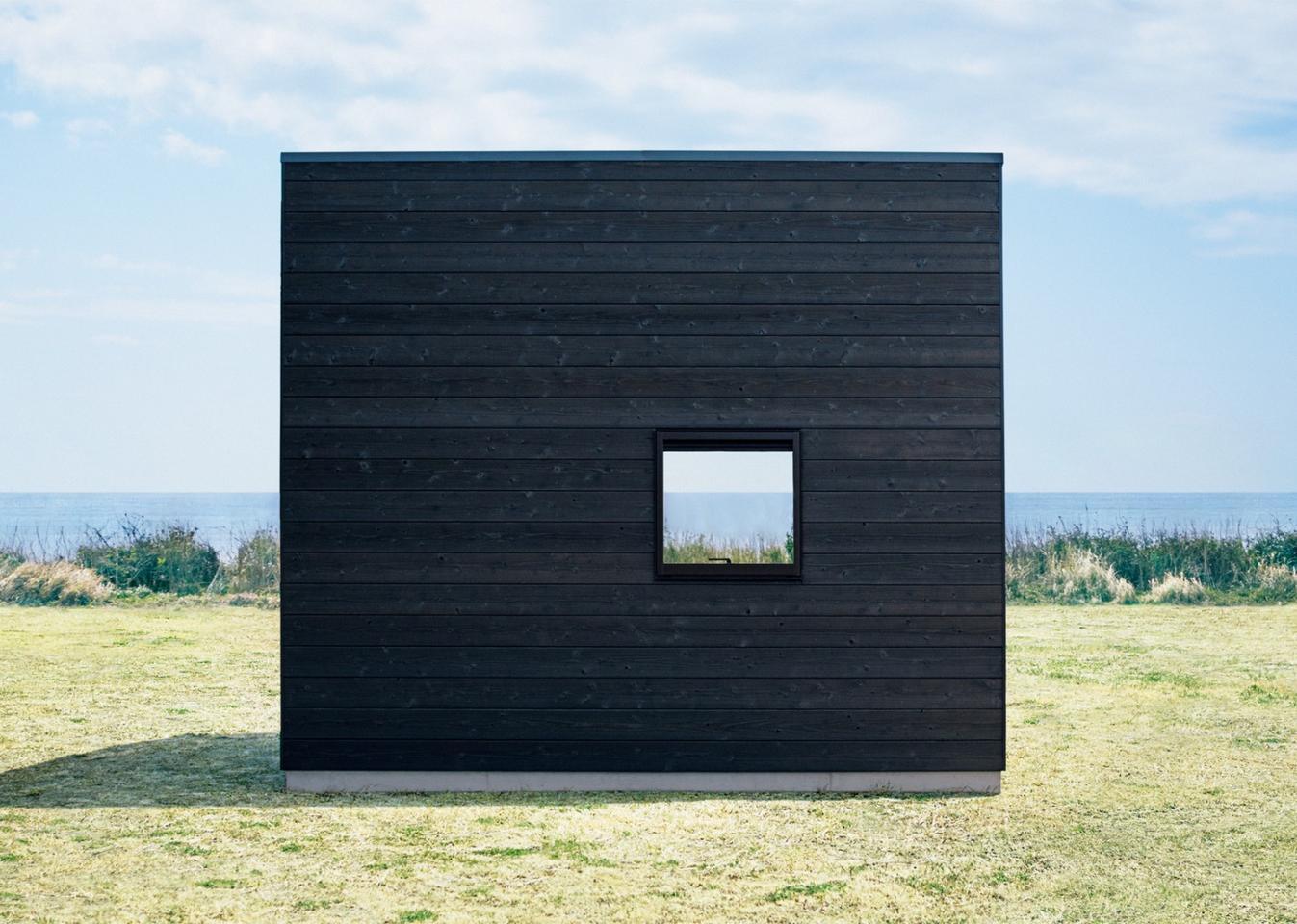 The Muji Hut'sexterior is Shou Sugi Ban-treated cedar