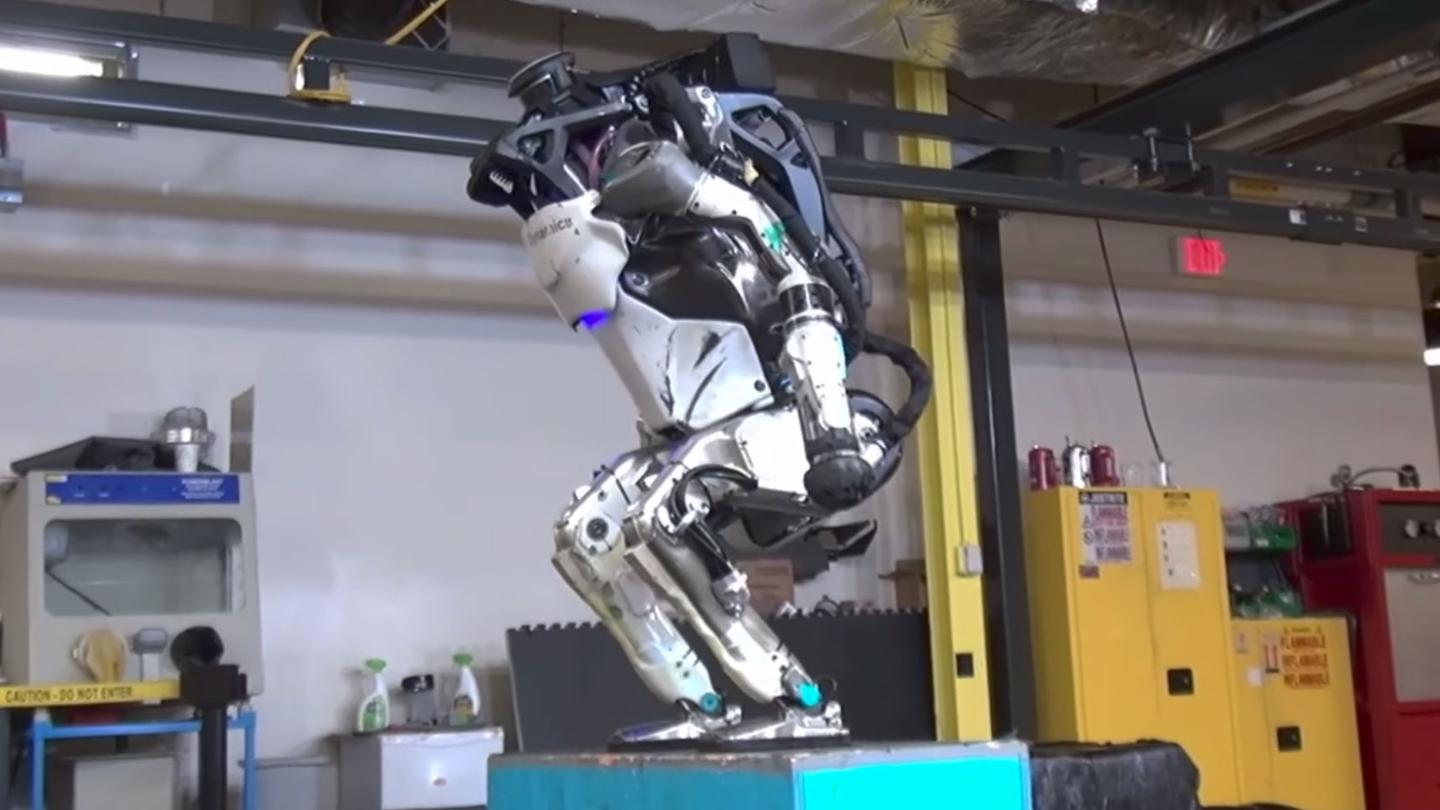 The Atlas robot prepares to launch itself into the air