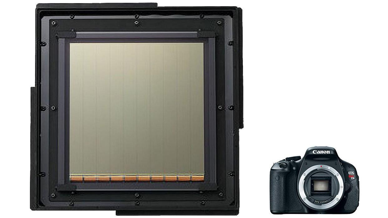 Canon's 20 cm square ultrahigh-sensitivity CMOS image sensor next to its Rebel T3i DSLR