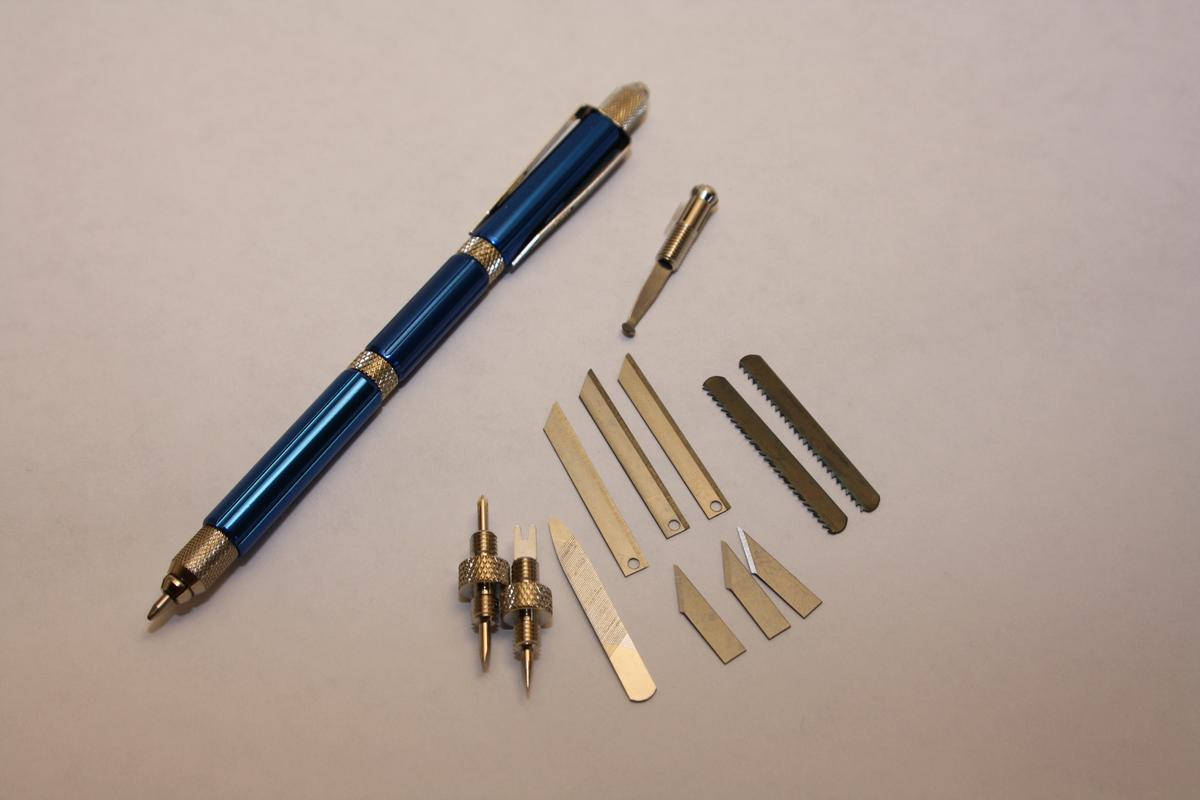 The 13 Function in 1 Pen, with its assortment of tools