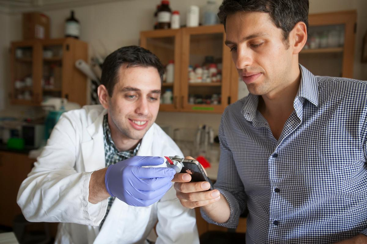 Graduate students Matthew Mancuso (left) and Vlad Oncescu, with the smartCARD