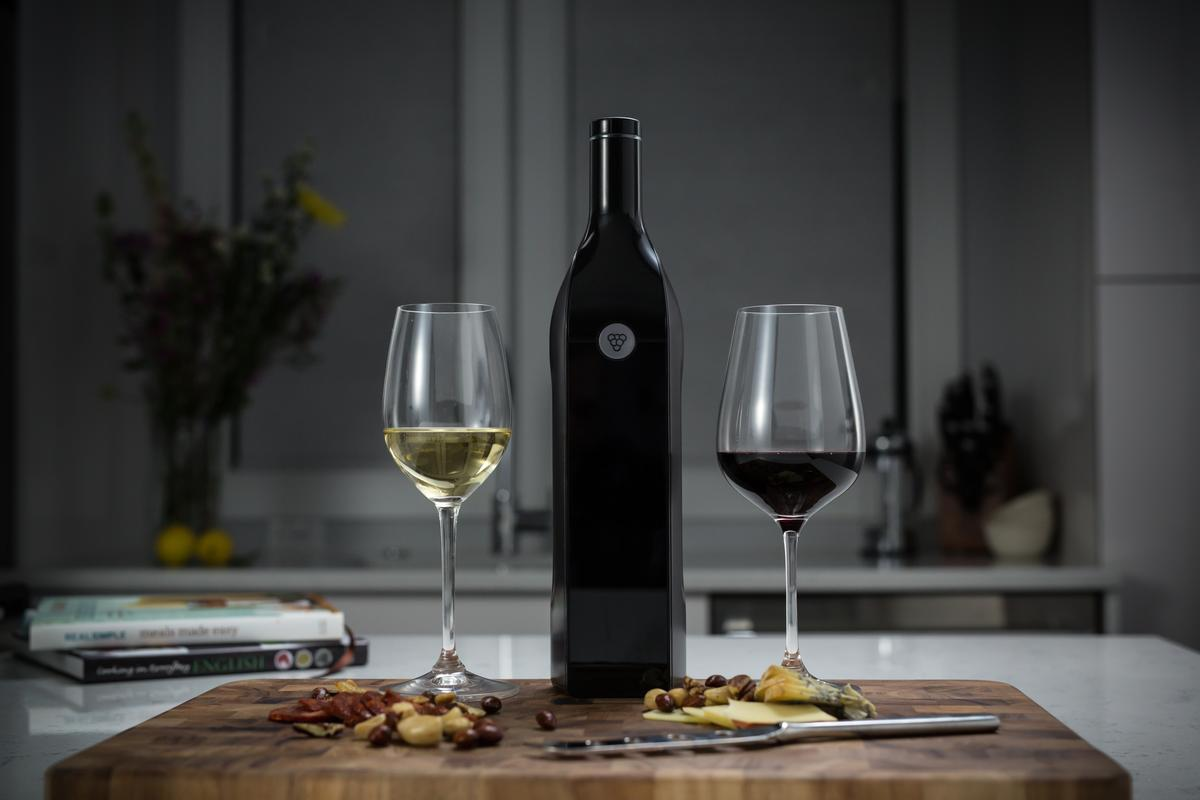 The Kuvee smart wine bottle features an integrated touchscreen, Wi-Fi connectivity, sensors, and an internal battery that's good for up to six hours per charge