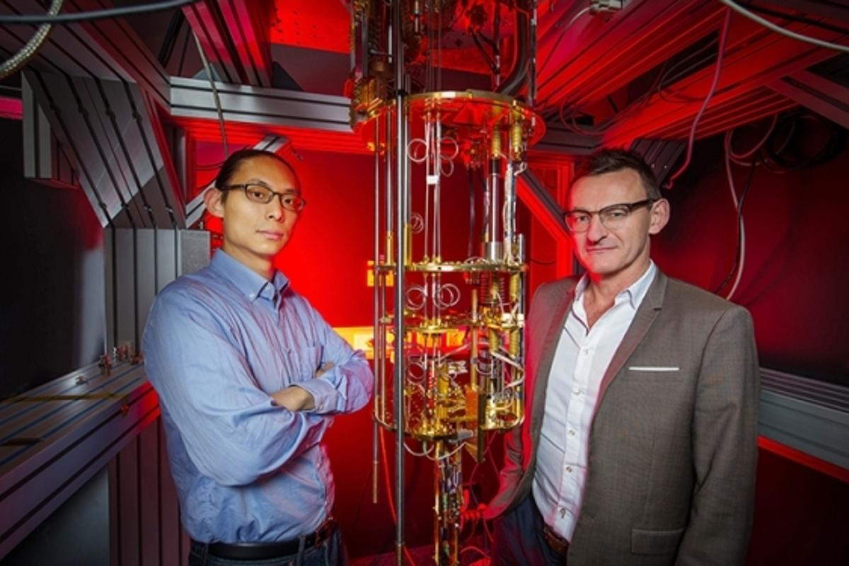 Dr Henry Yang and Professor Andrew Dzurak of UNSW, with the kind of large, expensive dilution refrigerator currently used to supercool quantum computing qubits. Their new hot qubit technology could remove the need for such bulky, expensive cooling systems