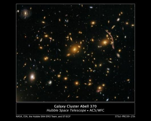 The Hubble Space Telescope's newly-repaired Advanced Camera for Surveys (ACS) has peered nearly 5 billion light-years away to resolve intricate details in the galaxy cluster Abell 370