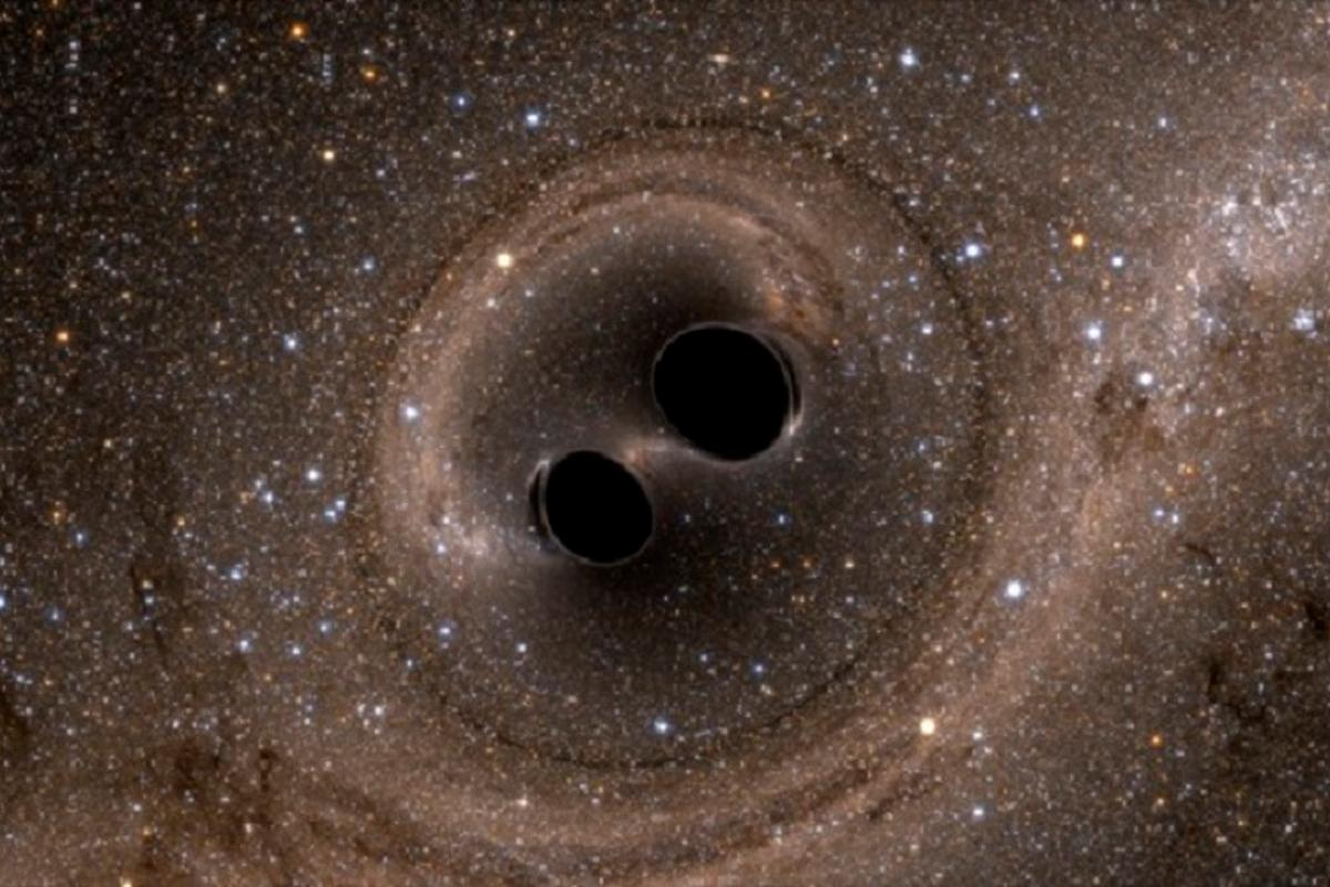 Two black holes colliding far out in space have produced gravity waves that have been detected by super-sensitive equipment on Earth for the very first time