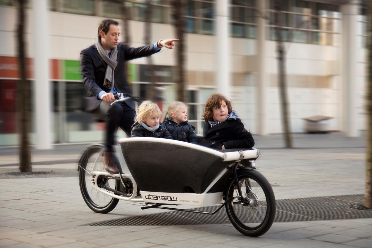 The Urban Arrow is an electric-assist Dutch cargo bike that can be reconfigured as needed