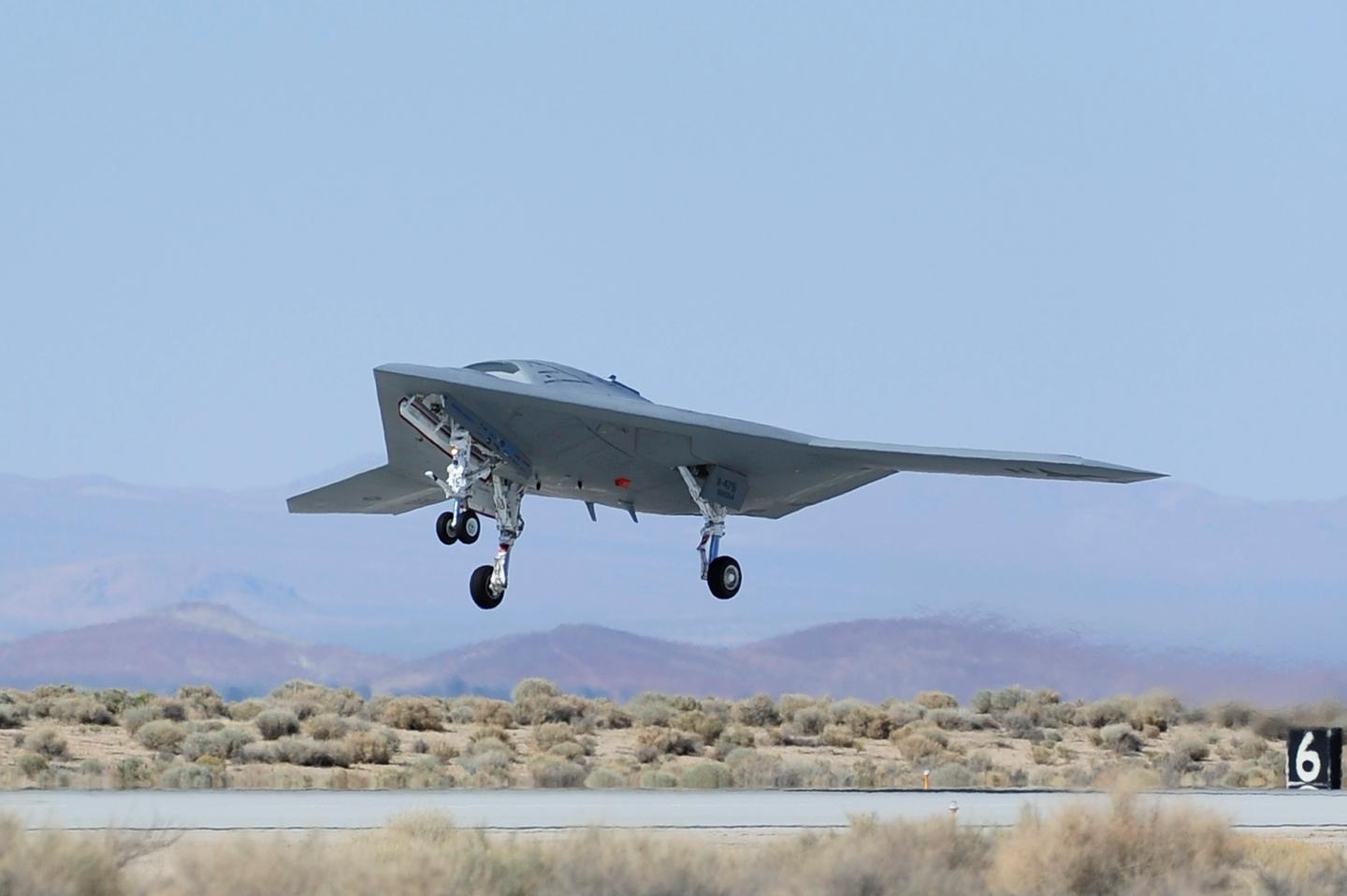 The second Northrop Grumman-built X-47B unmanned aircraft lifts off for one of its final flights during the air worthiness test phase at EAFB