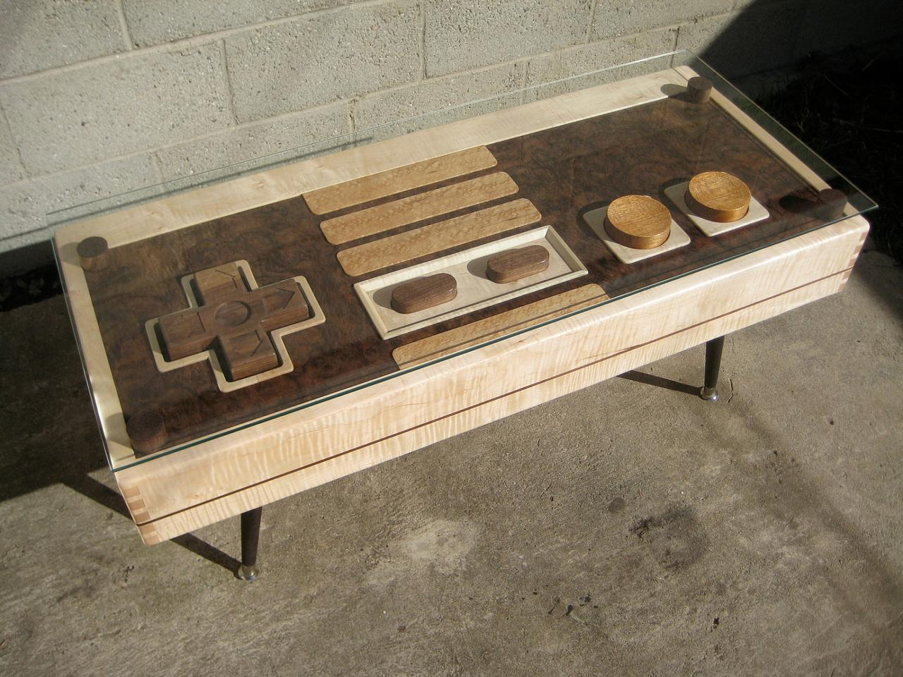 When not being used to control the onscreen action of favored NES classics like Super Mario, the table's huge wooden four-way directional pad and action buttons sit underneath a removable glass top