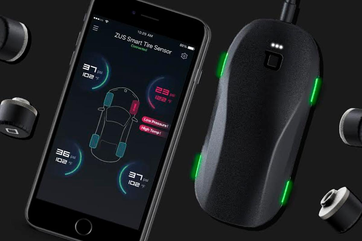 The  Zus Smart Tire Safety Monitor consists of sensors fastened to the tire valve and a wireless receiver that collects data to share with a smartphone app