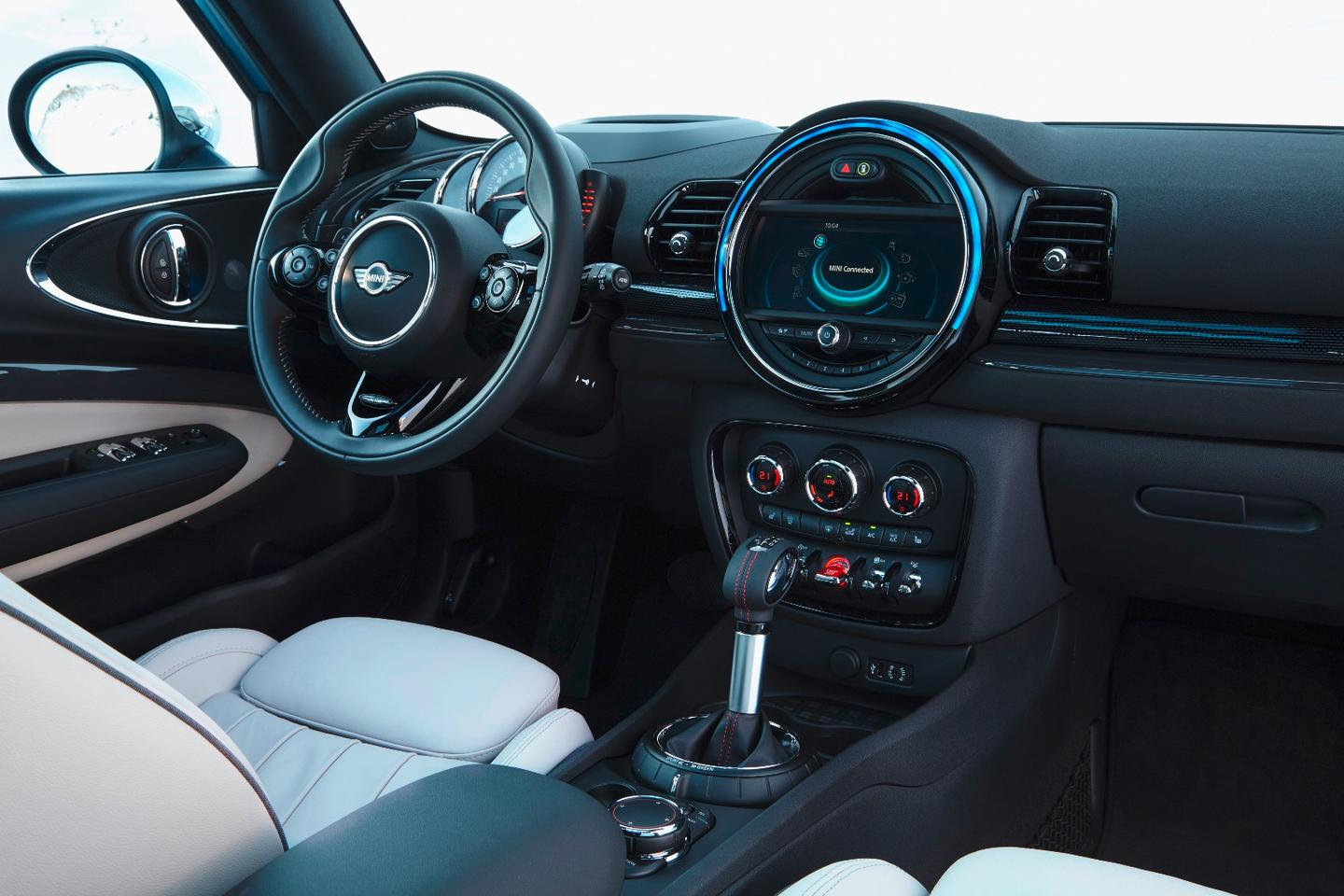 Interior features include the distinctive MINI Connected infotainment system and a head-up display