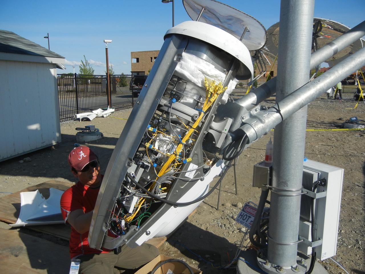 PNNL's thermochemical conversion device installed in front of a solar dish
