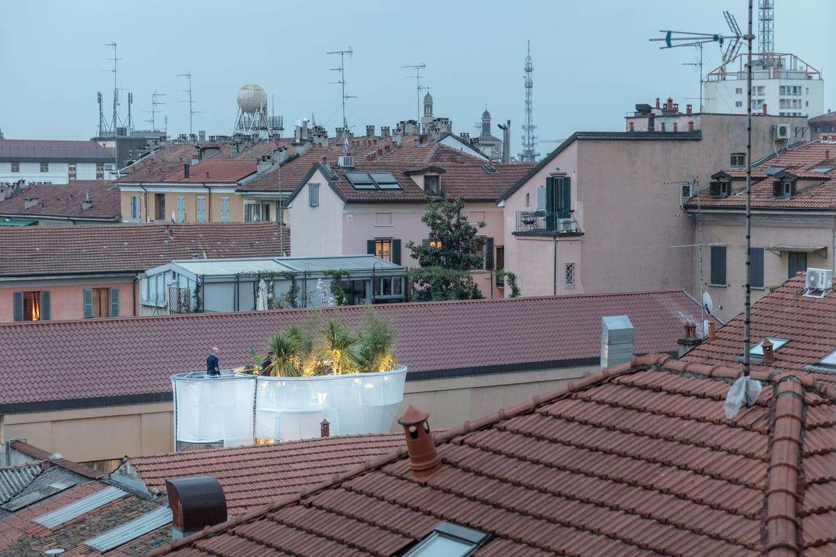 The rooftop garden of the Breathe installation pokes above the Milan roofline