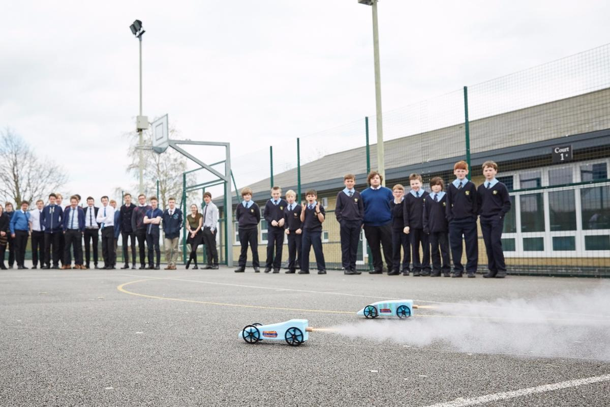 The model cars will be powered by small solid fuel rocket motors